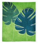 Blue And Green Palm Leaves Fleece Blanket by Linda Woods
