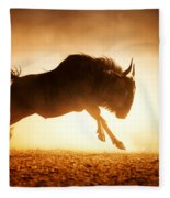 Blue Wildebeest Running In Dust Fleece Blanket