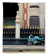 Blue Yellow Sporty Motorcycle Parked On Pavement Fleece Blanket