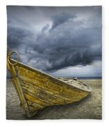 Boat On The Beach With Oncoming Storm Fleece Blanket