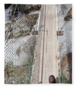 Boots On Narrow Swing Bridge Over White Water Fleece Blanket