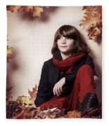 Boy Sitting On Autumn Leaves Artistic Portrait Fleece Blanket