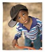 Boy Wearing Over Sized Hat Riding Bike Fleece Blanket
