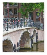 Bridge Over Canal With Bicycles  In Amsterdam Fleece Blanket
