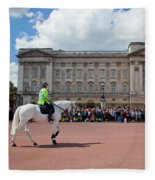 British Royal Guards Riding On Horse And Perform The Changing Of The Guard In Buckingham Palace Fleece Blanket
