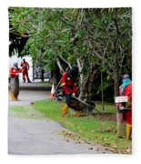 Camouflaged Leaf Blowers Working In Singapore Park Fleece Blanket