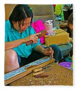 Child Watches As Mom Works In Teak Wood Carving Shop In Kanchanaburi-thailand Fleece Blanket