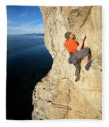 Climber Reaches For Hand Hold Fleece Blanket