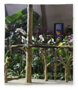 Colorful Macaws And Other Small Birds On Trees At An Exhibit Fleece Blanket