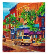 Corona Theatre Presents The Burgundy Lion Rue Notre Dame Montreal Street Scene By Carole Spandau Fleece Blanket