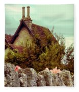 Cottage Seen Over A Wall Fleece Blanket
