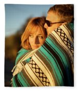Couple Wraps Themselves In A Blue Fleece Blanket