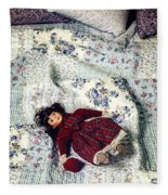 Doll On Bed Fleece Blanket