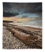 Driftwood Laying On The Gravel Beach Fleece Blanket