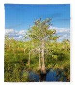 Dwarf Cypress Trees In A Field Fleece Blanket