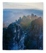 Early Morning Mist At The Bastei In The Saxon Switzerland Fleece Blanket