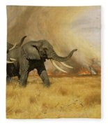 Elephants Moving Before A Fire Fleece Blanket