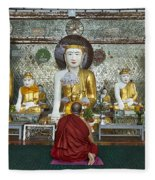 faithful Buddhist monk praying at Buddha Statues in SHWEDAGON PAGODA Fleece Blanket