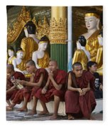faithful Buddhist monks siiting around Buddha Statues in SHWEDAGON PAGODA Fleece Blanket