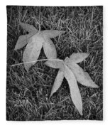 Fallen Autumn Leaves In The Grass During Morning Frost Fleece Blanket