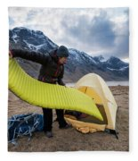 Female Hiker Sets Up Tent On Wild Fleece Blanket
