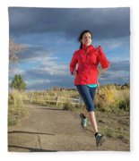 Female Runner In Colorado Fleece Blanket