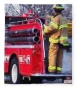 Fireman On Back Of Fire Truck Fleece Blanket