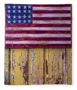 Flag On Old Yellow Door Fleece Blanket