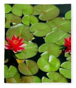 Floating Red Water Lilly Flowers On Pond Fleece Blanket