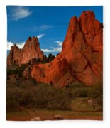 Fluffy Clouds Over Jagged Peaks Fleece Blanket
