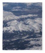 Flying Over The Snow Covered Rocky Mountains Fleece Blanket