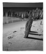 Footprints In The Sand Among The Pilings Fleece Blanket