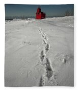 Footprints Leading From The Lighthouse Big Red During Winter Fleece Blanket