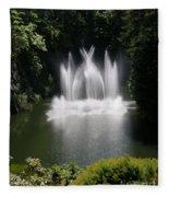 Fountain In Lake Fleece Blanket