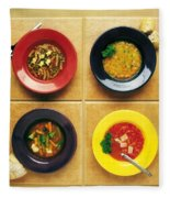 Four Dishes Of Different Food Fleece Blanket