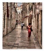 Girl In Red In The White Streets Of Dubrovnik Fleece Blanket