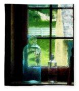 Glass Bottles On Windowsill Fleece Blanket