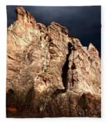 Glowing Under Storm Clouds Fleece Blanket
