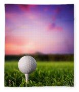Golf Ball On Tee At Sunset Fleece Blanket