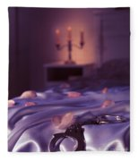 Handcuffs And Rose Petals On Bed Fleece Blanket