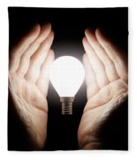 Hands Holding Light Bulb Fleece Blanket