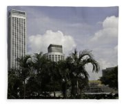 High Rise Buildings Behind Trees Along With Construction Work In Singapore Fleece Blanket