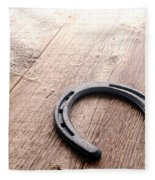 Horseshoe On Wood Floor Fleece Blanket