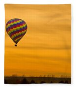 Hot Air Balloon In The Golden Sky Fleece Blanket