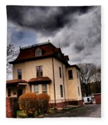 House With Storm Approaching Fleece Blanket
