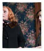 Inside A House, Two Women Stand Looking Fleece Blanket