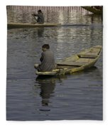 Kashmiri Men Rowing Many Small Wooden Boats In The Waters Of The Dal Lake Fleece Blanket