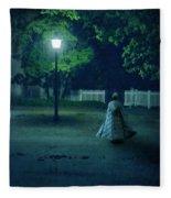 Lady In Vintage Clothing Walking By Lamplight Fleece Blanket