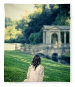 Lady Sitting On A Hill Above A Lake Fleece Blanket