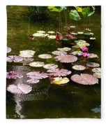 Lily Pads In The Fountain Fleece Blanket